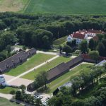 Nørre Vosborg in bird's eye view, facing north-west. The restored manor opened in 2008 with a hotel and restaurant. The long wing with the bright roof behind the northern power hose is a brand new hotel wing. Photo: Lis Helles Olesen.